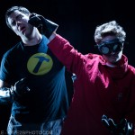 Photograph of Dr. Horrible punching Captain Hammer from Whedonesque Burlesque 2